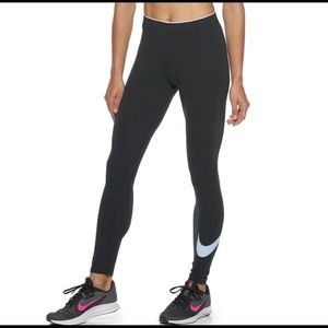 Small Woman's Nike leg a see pants